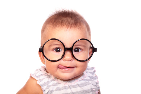 portrait of a beautiful baby with glasses